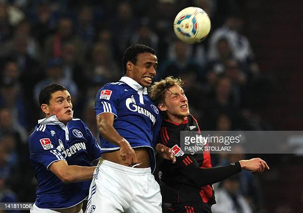 Schalke's Greek defender Kyriakos Papadopoulos Schalke's midfielder from Cameroon Joel Matip and Leverkusen's striker Stefan Kiessling vie for the...