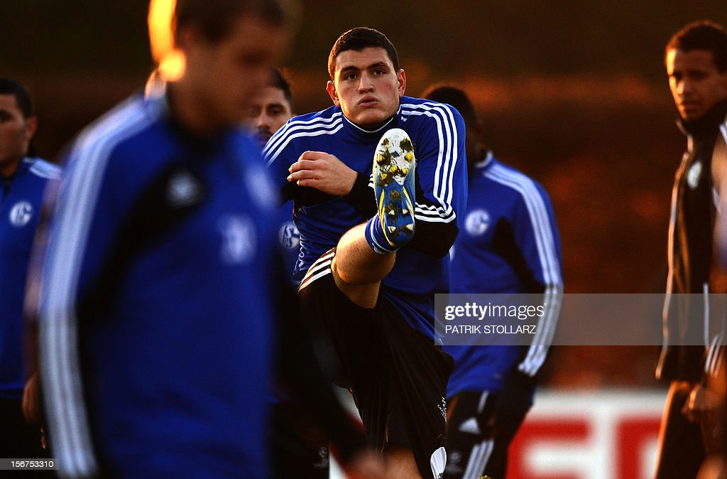 Schalke's Greek defender Kyriakos Papadopoulos (C) warms up during a training session at the training ground, in Gelsenkirchen,western Germany on November 20, 2012, on the eve of the UEFA Champions League football match against Olympiacos Piraeus.
