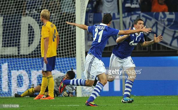 Schalke`s Greek midfielder Kyriakos Papadopoulos and Schalke's midfielder Julian Draxler celebrate after the 41 during the UEFA Europa League playoff...