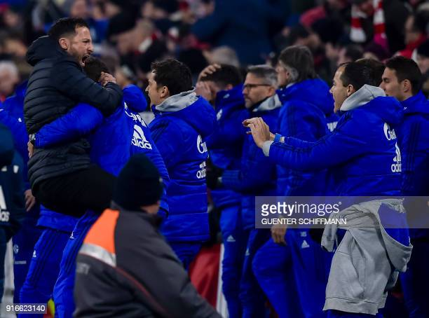 Schalke's head coach Domenico Tedesco celebrates the first goal for his team during the German first division Bundesliga football match FC Bayern...