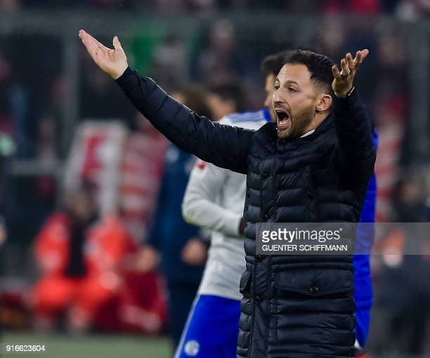 Schalke's head coach Domenico Tedesco gestures on the pitch during the German first division Bundesliga football match FC Bayern Munich vs Schalke 04...