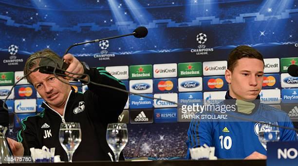 Schalke's head coach Jens Keller and Schalke's midfielder Julian Draxler answer questions during a press conference at the press room, in...