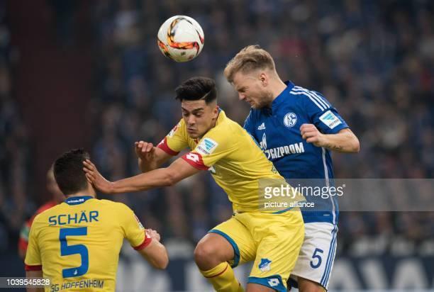 Schalke's Johannes Geis in action against Hoffenheim's Nadiem Amiri and Fabian Schaer during the German Bundesliga soccer match between FC Schalke 04...