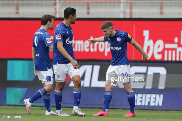 Schalke's Jonjoe Kenny right celebrates after scoring his side's first goal during the Bundesliga match between 1 FC Union Berlin and FC Schalke 04...