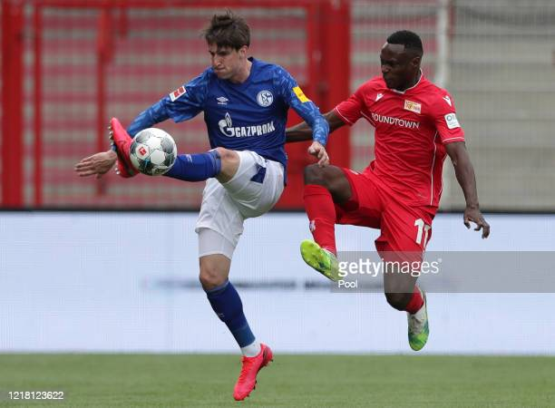 Schalke's Juan Miranda left fights for the ball with Union's Anthony Ujah during the Bundesliga match between 1 FC Union Berlin and FC Schalke 04 at...