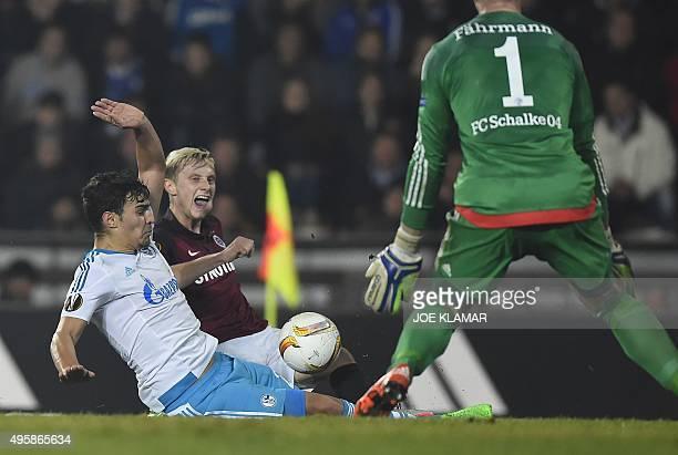 Schalke's Kaan Ayaan and Prague´s Ladislav Krejci vie for the ball during the UEFA Europa League football match AC Sparta Praha vs FC Schalke 04 in...