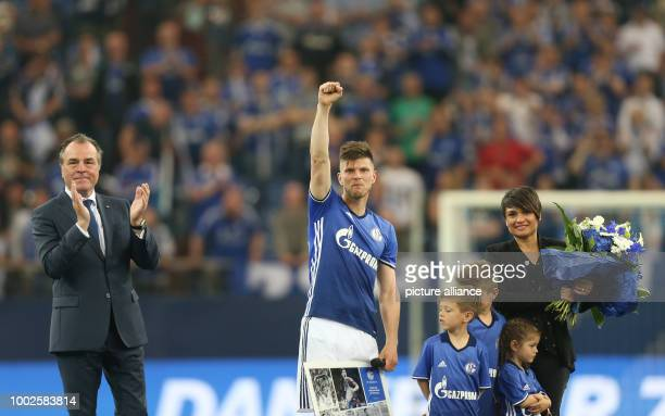 Schalke's KlaasJan Huntelaarand his family stands next to chairman of the board Clemens Toennies during his farewell after the German Bundesliga...