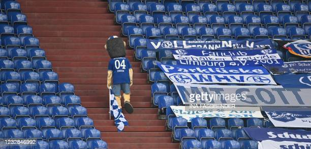 Schalke's mascot Erwin leaves the stands after the German first division Bundesliga football match FC Schalke 04 v Hertha Berlin on May 12, 2021 in...
