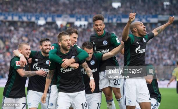 Schalke's Max Meyer Daniel Caligiuri goal scorer Guido Burgstaller Leon Goretzka Yevhen Konoplyanka Thilo Kehrer and Naldo celebrate the 20 goal...