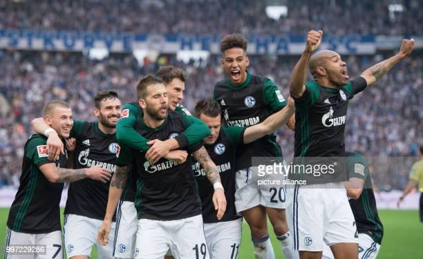 Schalke's Max Meyer Daniel Caligiuri goalkeeper Guido Burgstaller Leon Goretzka Yevhen Konoplyanka Thilo Kehrer and Naldo celebrate the 20 goal...