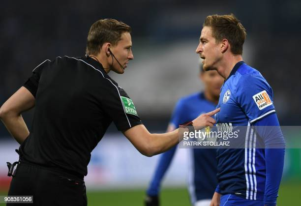 Schalke's midfielder Bastian Oczipka argues with referee Martin Petersen during the German First division Bundesliga football match FC Schalke 04 vs...
