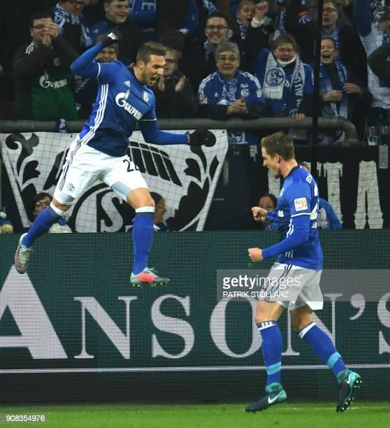 Schalke's midfielder Bastian Oczipka congratulates teammate Marko Pjaca after he scored a goal during the German First division Bundesliga football...