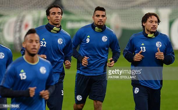 Schalke's midfielder Dennis Aogo Cameroonian defender Joel Matip midfielder Kevin Prince Boateng and US midfielder Jermaine Jones warm up during a...