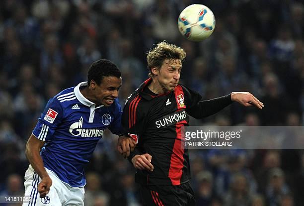Schalke's midfielder from Cameroon Joel Matip and Leverkusen's striker Stefan Kiessling vie for the ball during the German first division Bundesliga...