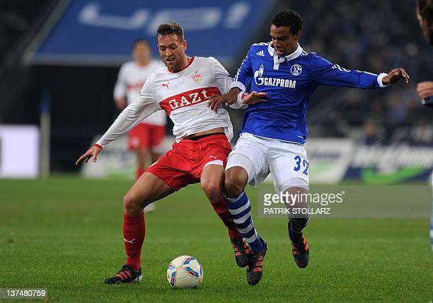Schalke's midfielder from Cameroon Joel Matip and Stuttgart's striker Julian Schieber vie for the ball during the German first division Bundesliga...