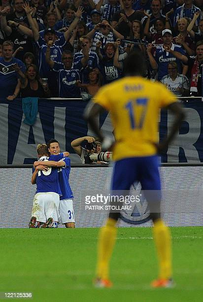 Schalke's midfielder Julian Draxler and Lewis Holtby celebrate after the UEFA Europa League playoff football match Schalke 04 vs HJK Helsinki in the...