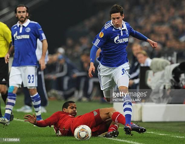 Schalke's midfielder Julian Draxler and Twente's Swedish forward Emir Bajrami vie for the ball during the secondleg of the UEFA Europa League round...
