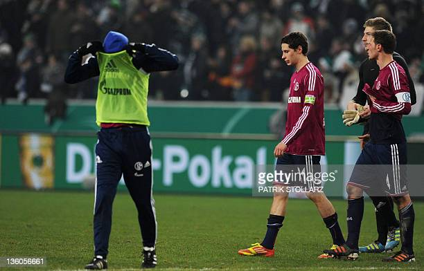 Schalke's midfielder Julian Draxler reacts after the German DFB cup football match Borussia Moenchengladbach vs FC Schalke in the German city of...
