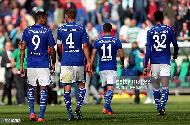 Schalke's midfielder Kevin Prince Boateng defender Benedikt Hoewedes midfielder Christian Clemens and Cameroonian defender Joel Matip leave the pitch...