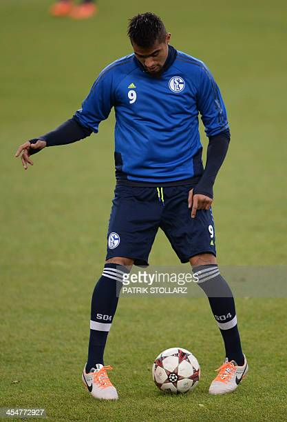 Schalke's midfielder Kevin Prince Boateng warms up during a training session in Gelsenkirchen western Germany on December 10 on the eve of the UEFA...