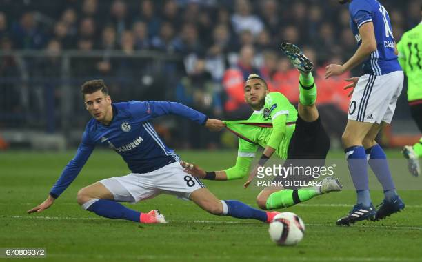 Schalke's midfielder Leon Goretzka and Ajax Amsterdam's midfielder Hakim Ziyech vie for the ball during the UEFA Europa League 2ndleg quarterfinal...