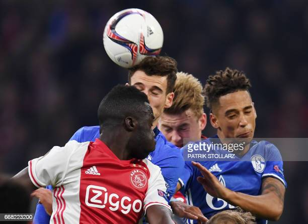 Schalke's midfielder Leon Goretzka Schalke's defender Thilo Kehrer and Ajax Amsterdam's defender Davinson Sanchez vie for the ball during the UEFA...