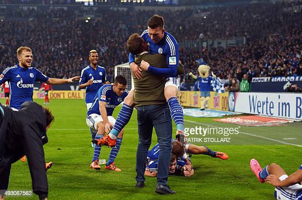Schalke's midfielder Max Meyer and his teammates celebrate during the German first division Bundesliga football match FC Schalke 04 vs Hertha BSC...