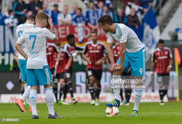 Schalke's midfielder Max Meyer and Schalke's Argentinian striker Franco di Santo look on as Ingolstadt's players celebrate their second goal during...