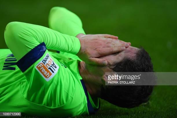 Schalke's midfielder Sebastian Rudy reacts during the German First division Bundesliga football match between Monchengladbach and Shalke 04 on...
