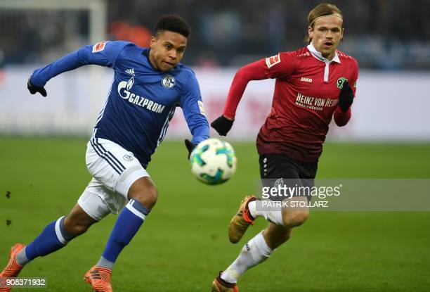 Schalke's midfielder Weston McKennie and Hanover's Norwegian midfielder Iver Fossum vie for the ball during the German First division Bundesliga...
