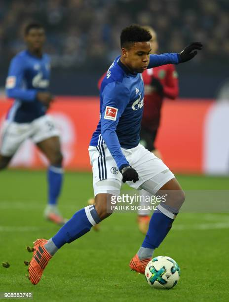 Schalke's midfielder Weston McKennie runs with the ball during the German First division Bundesliga football match FC Schalke 04 vs Hanover 96 in...