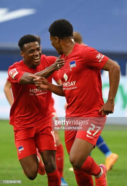 Schalke's Moroccan midfielder Nassim Boujellab and Hertha Berlin's German forward Jessic Ngankam celebrate the 1-2 during the German first division...