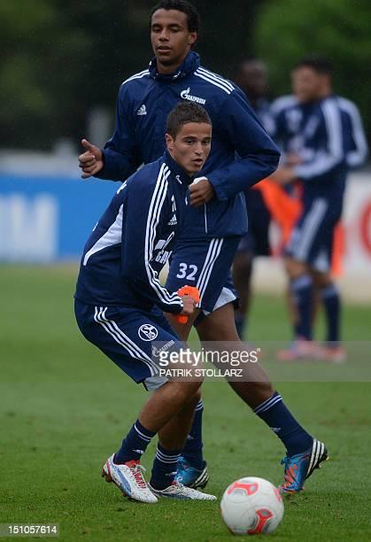 Schalke's new recruit Dutch striker Ibrahim Afellay and Schalke's Cameroonian defender Joel Matip attend a training session on August 31 2012 in...