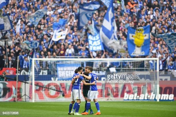 TOPSHOT Schalke's player react after the German first division Bundesliga football match FC Schalke 04 vs SC Freiburg in Gelsenkirchen western...