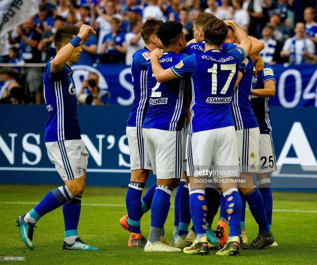 Schalke's players celebrate after scoring the 1-0during the German first division Bundesliga football match FC Schalke 04 vs Eintracht Frankfurt in Gelsenkirchen, western Germany, on May 12, 2018. (Photo by SASCHA SCHUERMANN / AFP)
