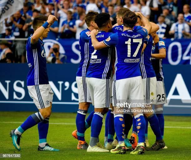 Schalke's players celebrate after scoring the 10during the German first division Bundesliga football match FC Schalke 04 vs Eintracht Frankfurt in...