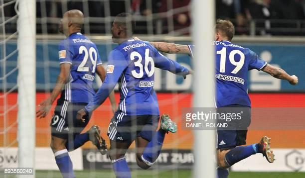 Schalke's players celebrate Schalke's Brazilian defender Naldo scoring the 22 during the German first division Bundesliga football match between FC...