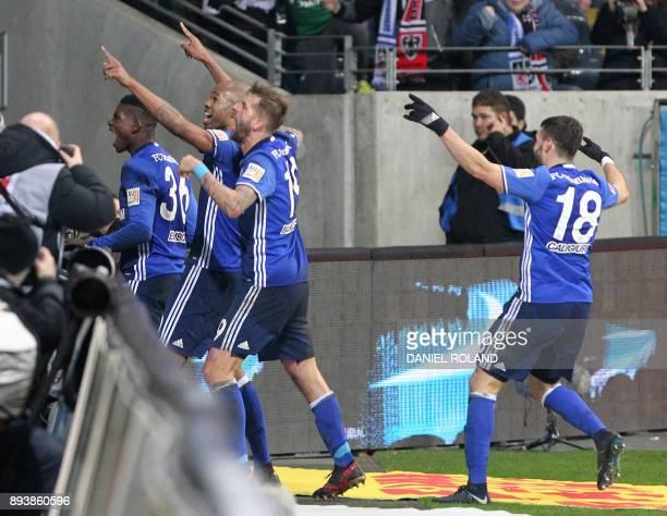 Schalke's players celebrate scoring the 22 during the German first division Bundesliga football match between FC Schalke 04 and Eintracht Frankfurt...