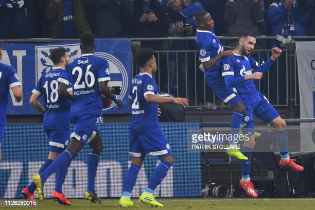 Schalke's players congratulate Schalke's Algerian midfielder Nabil Bentaleb after he scored a second goal during the UEFA Champions League round of...
