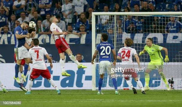 Schalke's Sead Kolasinac heads a goal which is delcared void during the German Bundesliga soccer match between FC Schalke 04 and Hamburger SV at the...