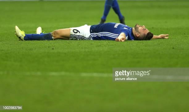 Schalke's Sead Kolasinac lies on the ground after the German Bundesliga soccer match between FC Schalke 04 and Hamburger SV at the Veltins Arenain...