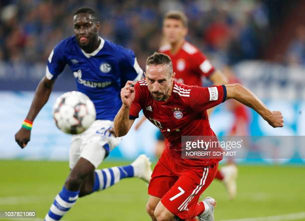 Schalke's Senegalese defender Salif Sane and Munich's French midfielder Franck Ribery vie with the ball during the German First division Bundesliga...