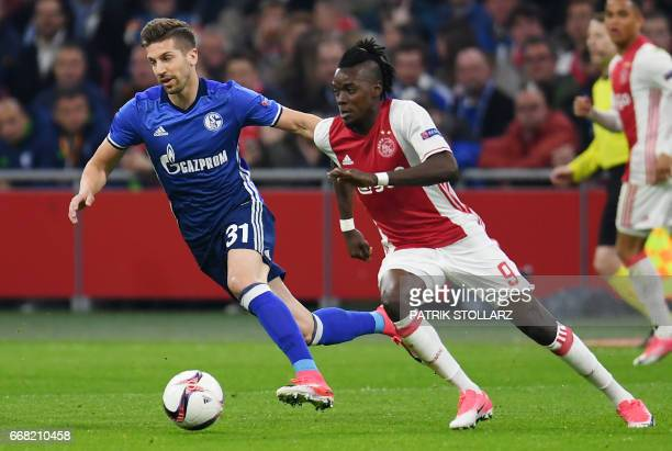 Schalke's Serbian defender Matija Nastasic and Ajax Amsterdam's midfielder Bertrand Traore vie for the ball during the UEFA Europa League football...