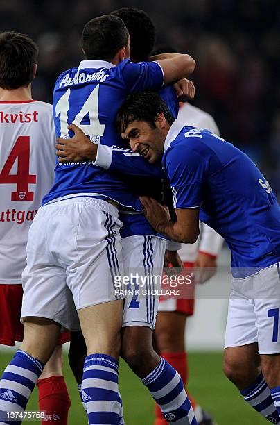 Schalke's Spanish striker Raul Schalke's Greek defender Kyriakos Papadopoulos and Schalke's midfielder from Cameroon Joel Matip celebrate after...