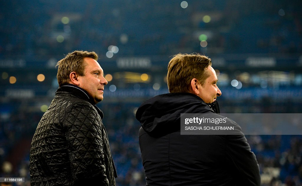 Schalke's Sports Director Horst Heldt (R) and Schalke's head coach Andre Breitenreiter are pictured during during the German first division Bundesliga football match of Schalke 04 vs VfB Stuttgart in Gelsenkirchen, western Germany, on February 21, 2016. / AFP / SASCHA