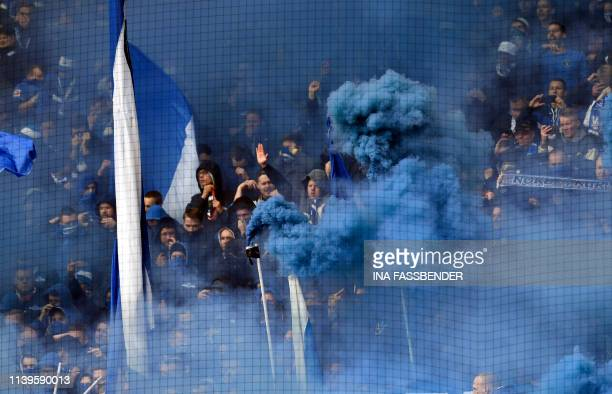 Schalke's supporter set off blue smoke bombs prior to the German First division Bundesliga football match BVB Borussia Dortmund v Schalke 04 in...