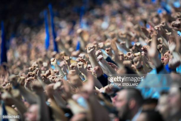 Schalke's supporters celebrate during the German first division Bundesliga football match FC Schalke 04 vs Borussia Dortmund in Gelsenkirchen western...