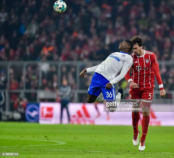 Schalke's Swiss forward Breel Embolo and Bayern Munich's German defender Mats Hummels vie for the ball during the German first division Bundesliga...