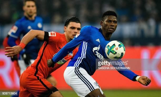 Schalke's Swiss forward Breel Embolo and Berlin's Dutch defender Karim Rekik vie for the ball during the German first division Bundesliga football...