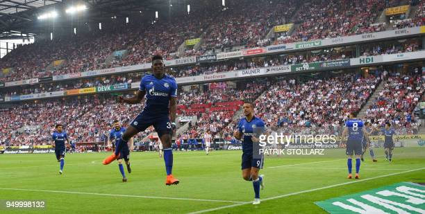 Schalke's Swiss forward Breel Embolo and his teammates celebrate after scoring during the German first division Bundesliga football match FC Cologne...